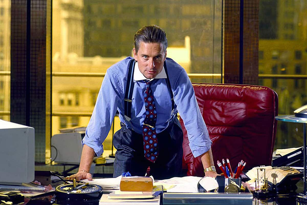 Hollywood actor leaning on messy desk