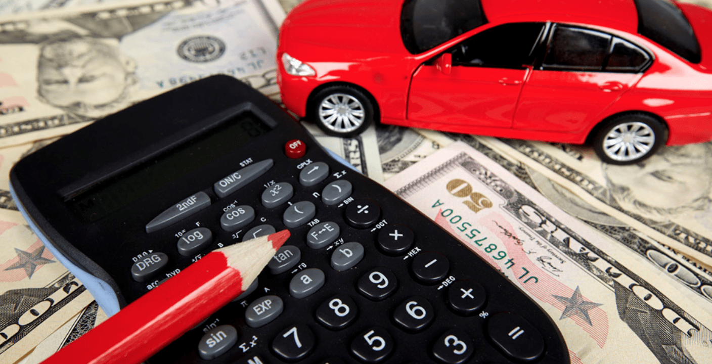 car toy and calculator on money