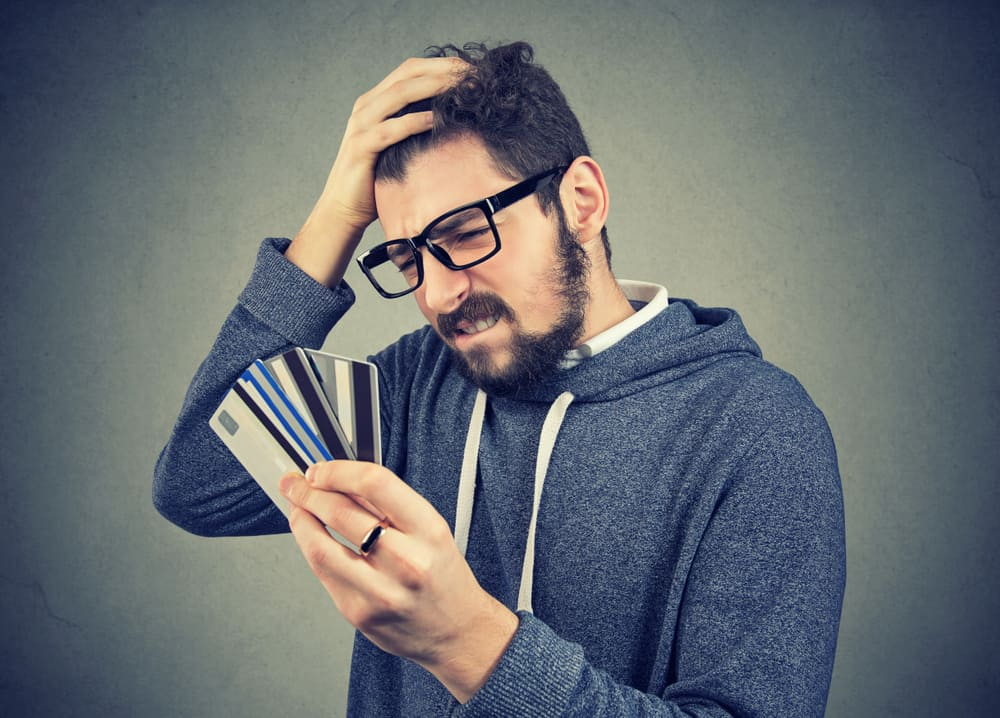 man frustrated at credit card debt