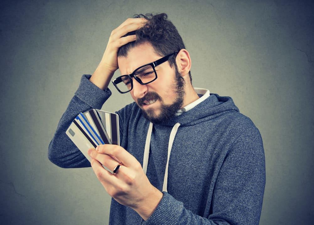 man frustrated at credit card debt