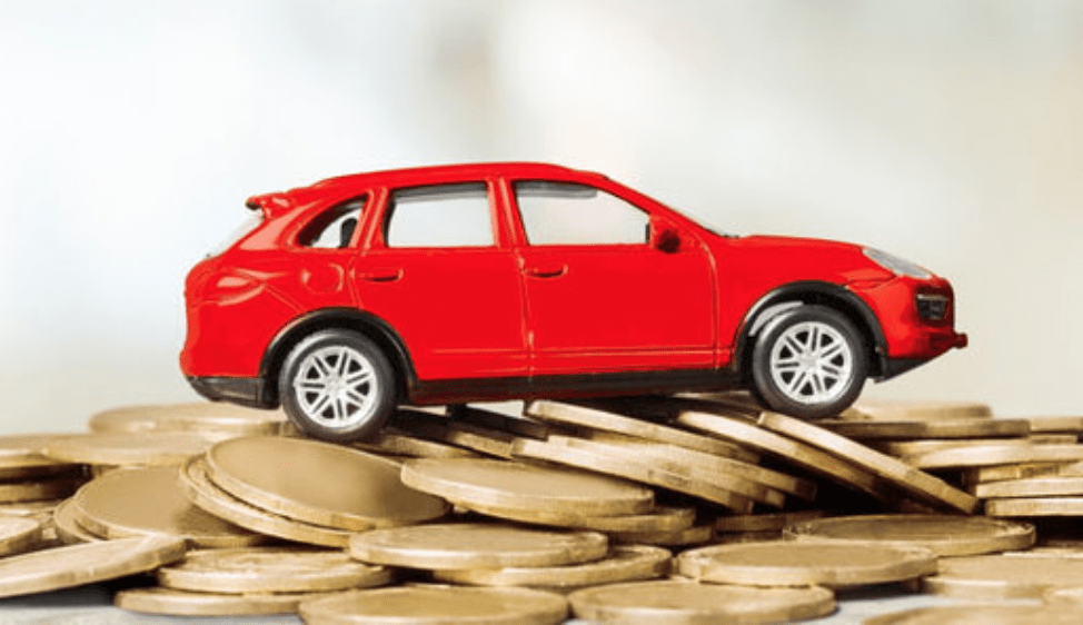 car model on coin pile